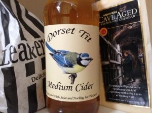 Leakers Bakery's 100% wholemeal loaf, a hunk of Ford Farm's cave aged Wookey Hole Cheddar, and Dorset Tit, bottled by Marshwood Vale Cider.